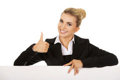 Happy businesswoman holding empty billboard Stock Photography