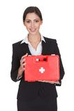 Happy businesswoman holding first aid box. Isolated On White Stock Photos