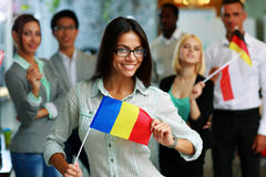 Happy businesswoman holding flag of Romania Royalty Free Stock Photography