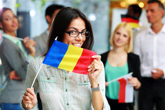 Happy businesswoman holding flag of Romania Royalty Free Stock Image