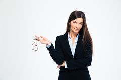Happy businesswoman holding glasses Stock Photography