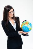 Happy businesswoman holding globe Royalty Free Stock Photo