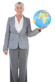 Happy businesswoman holding globe Stock Image