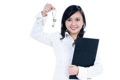 Happy businesswoman holding key and clipboard Royalty Free Stock Photos