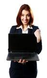 Happy businesswoman holding laptop Stock Photography