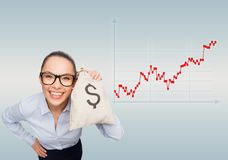 Happy businesswoman holding money bag with dollar Royalty Free Stock Image