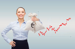 Happy businesswoman holding money bags with dollar Royalty Free Stock Photography