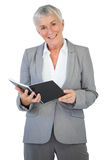 Happy businesswoman holding notepad Stock Images