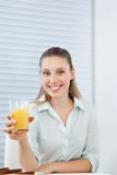 Happy Businesswoman Holding Orange Juice Royalty Free Stock Photos