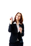 Happy businesswoman holding paper plane Stock Photo