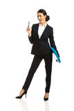 Happy businesswoman holding a pen Royalty Free Stock Photography