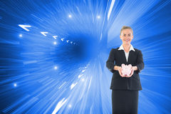 Happy businesswoman holding a piggy bank Royalty Free Stock Photo