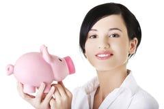 Happy businesswoman holding piggy bank Stock Photos