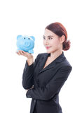 Happy businesswoman holding piggy bank Royalty Free Stock Photo