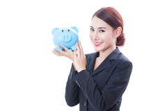 Happy businesswoman holding piggy bank Royalty Free Stock Photography