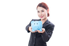 Happy businesswoman holding piggy bank Royalty Free Stock Image