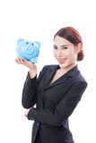 Happy businesswoman holding piggy bank Royalty Free Stock Images