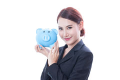 Happy businesswoman holding piggy bank Royalty Free Stock Photos