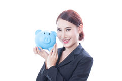 Happy businesswoman holding piggy bank Stock Image