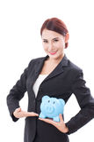 Happy businesswoman holding piggy bank Stock Photos