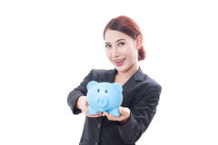 Happy businesswoman holding piggy bank Stock Photo