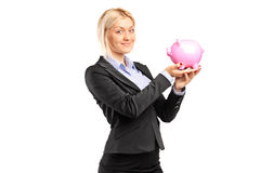 Happy businesswoman holding a piggybank Stock Images