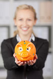 Happy Businesswoman Holding Piggybank Royalty Free Stock Image
