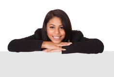 Happy businesswoman holding placard Stock Images
