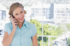 Happy businesswoman holding smartphone Royalty Free Stock Images