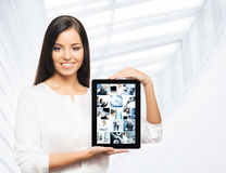 A happy businesswoman holding a tablet Stock Photo