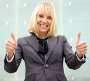 A happy businesswoman is holding thumbs up Royalty Free Stock Photo