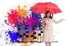 Happy businesswoman holding umbrella Stock Image