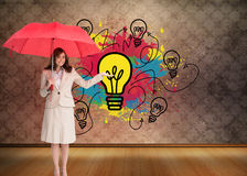 Happy businesswoman holding umbrella Royalty Free Stock Image