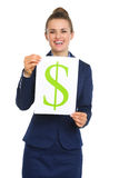 Happy businesswoman holding up sheet of paper with dollar sign Royalty Free Stock Images