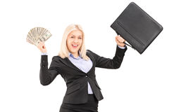 A happy businesswoman holding US dollars and briefcase Royalty Free Stock Images