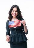 Happy businesswoman holding US flag Stock Photo