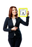 Happy businesswoman holding wall clock Royalty Free Stock Image