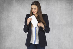 Happy businesswoman holds a bribe Royalty Free Stock Photography