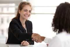 Happy businesswoman hr manager handshake hire candidate selling insurance services stock images