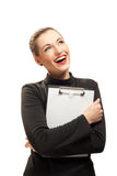Happy businesswoman isolated on white. Happy beautiful businesswoman with clipboard isolated on white background Stock Photography
