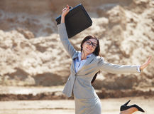 Happy businesswoman jumping in the air Stock Images
