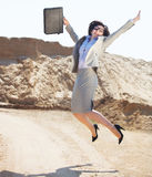Happy businesswoman jumping in the air Stock Photo