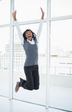 Happy businesswoman jumping Stock Images