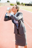 Happy businesswoman kissing her trophy Stock Images