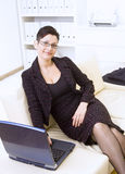Happy businesswoman with laptop Royalty Free Stock Photo