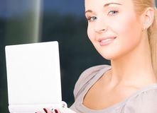 Happy businesswoman with laptop computer Stock Images
