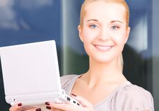 Happy businesswoman with laptop computer Stock Photo