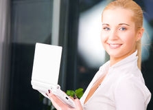Happy businesswoman with laptop computer Royalty Free Stock Photos