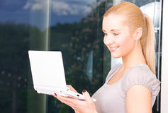 Happy businesswoman with laptop computer Royalty Free Stock Images