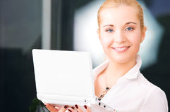 Happy businesswoman with laptop computer Stock Image